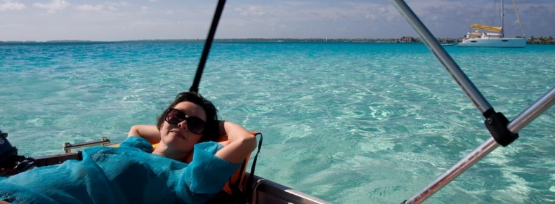 "Woman relaxing on a boat in ""Bora Bora"""
