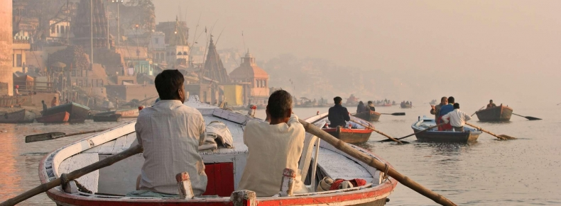 Ganges river. People coming and going by boat on the early morning